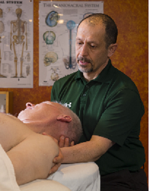 photo illustrating therapis giving neck massage