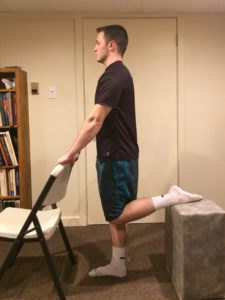 picture of Quadricep stretch demonstrated with chair