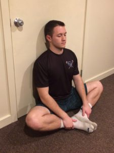 picture demonstrating seated adductor muscle or groin stretch